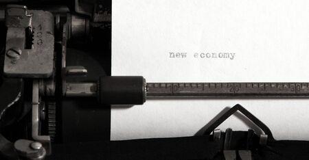 new economy: New economy concept on old typewriter.