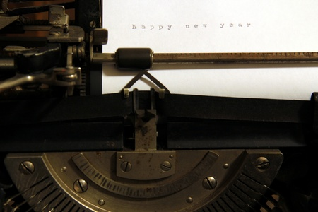 Happy new year word concept on old typewriter. photo