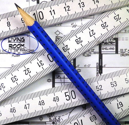 Design a house with blue print, wooden meter and pen. photo