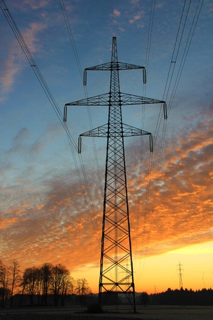 Electric masts in early morning with beautiful skyand clouds. photo
