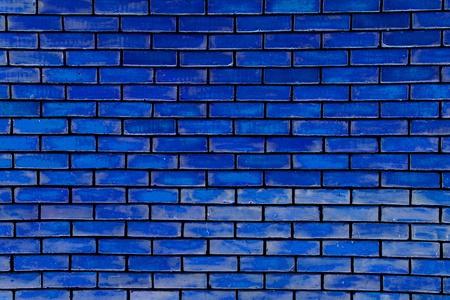 Modrá zděná zeď jako krásnou texturu. Reklamní fotografie