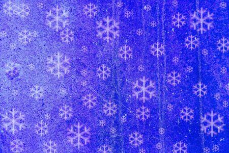 Blue snowflakes on mold like background. photo