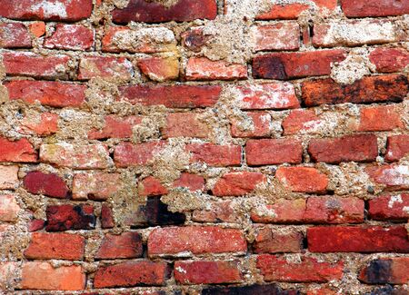 Old wall with colorful bricks. photo