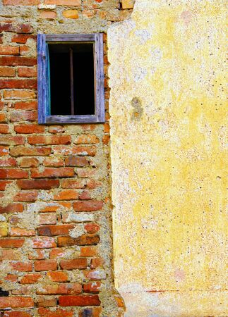 Old window on very old house. Stock Photo