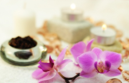 Purple orchid, white candle, salt and rocks as a concept of healthy living, relaxing, spa, etc. photo