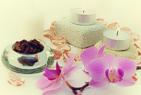 Spa concept; candles, cloves, orchid and glass stones. photo
