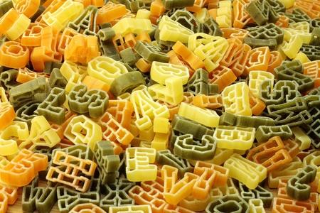 Pasta in shape of letters as background. Standard-Bild