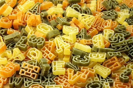 Pasta in shape of letters as background. Stock Photo - 12325404