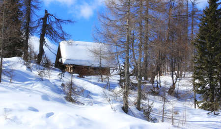 Beautiful cabin and winter scene in high mountains. photo