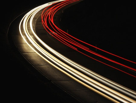 highway lights: Fast cars are leaving light trails on night road