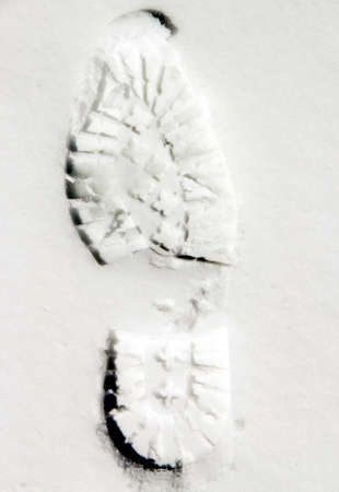 shoeprint: Shoeprint on white snow