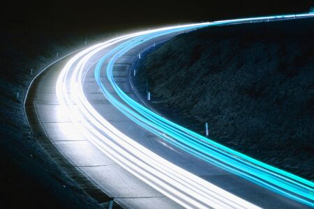car lights: Blue trails of cars on the road at night