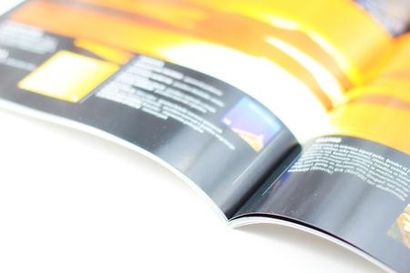 open magazine: Shiny magazine on white table  Stock Photo