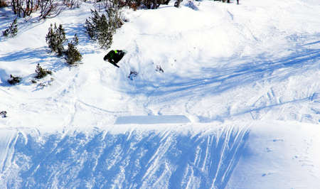 Snowboarder is jumping  photo
