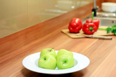 Red peppers, green apples and parsley in the kitchen  Stock Photo - 12668751