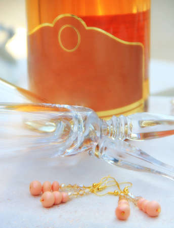 Bottle of vine, glasess and earings