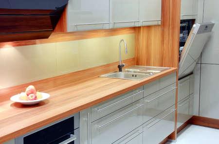 Apples in new kitchen with open dishwasher  Standard-Bild
