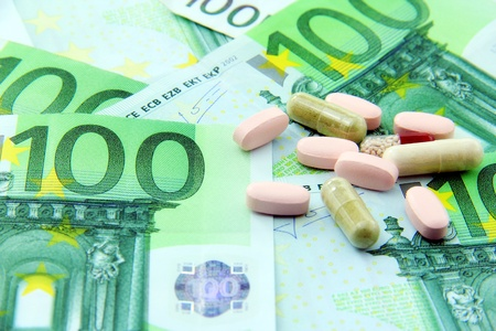 health care concept: Expenses in health care concept; money and pills