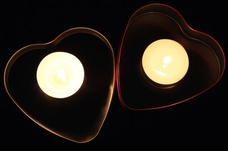 Two hearts and candles in them  photo
