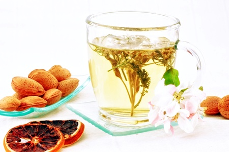 dring: Sweet dring with herbs in the cup and dried fruits for decoration