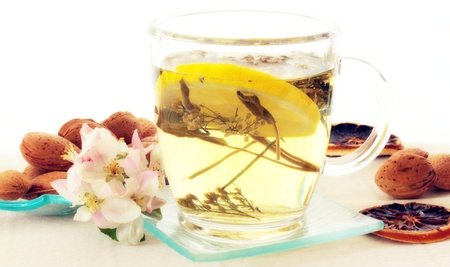 Healthy drink with lemon and apple blossom for decoration  Stock Photo - 13322246