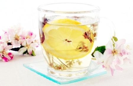 Lemon tea with apple blossom for decoration  photo