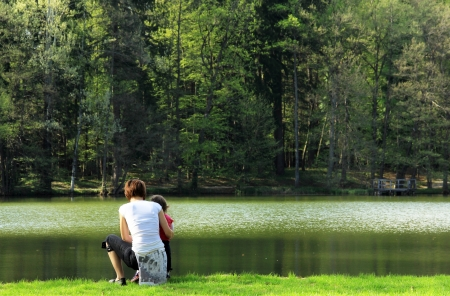 Mother and her child near the lake