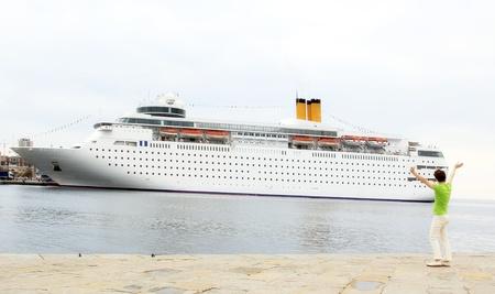 Young woman and big ship  photo