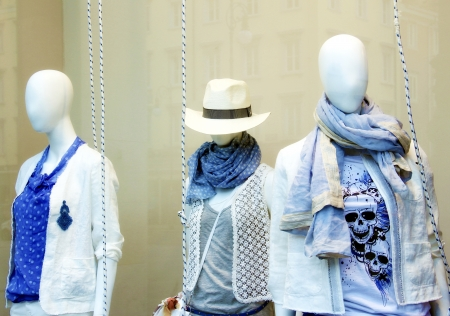 body shop: Mannequins behind the showcase  Stock Photo