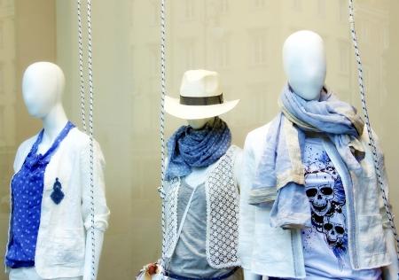 Mannequins behind the showcase  Standard-Bild