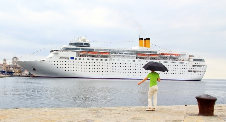 Young woman is hitchiking big cruiser  photo