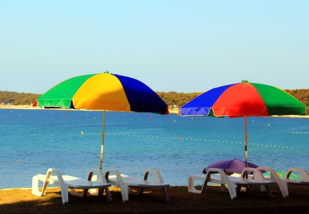 Umbrellas and chairs for relaxation near the beach  photo