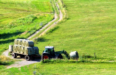Tractor is pulling bale on trailer  photo