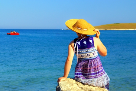 gentle dream vacation: Gentle young woman observing the sea   Stock Photo
