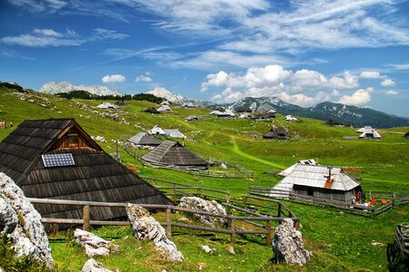 High mountains and cabins on beautiful summer day  photo