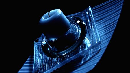 Candle in the candlestick in the dark. Stock Photo