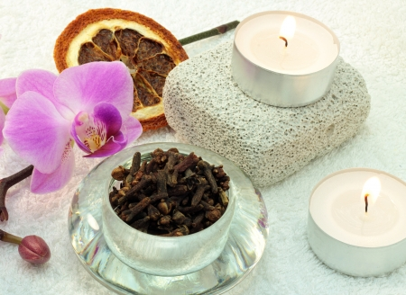 Orange, cloves, candle and orchid for spa  Stock Photo