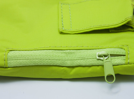 Zip pockets of green leaves and a steel chain for hanging  photo