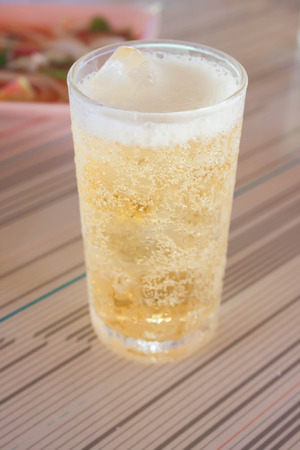 peppery: Golden beer with a spicy peppery taste  Stock Photo