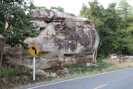 pan tropical: TRAFFIC is a large stone building.