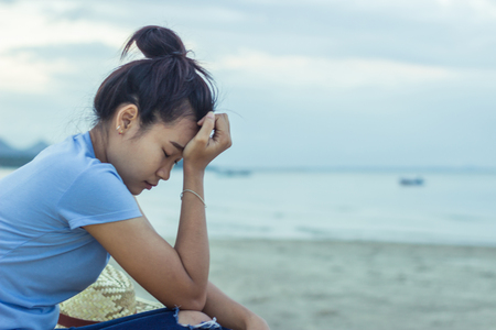 young asian girl in sad emotion on beach Stock Photo