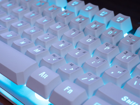 Keyboard with blue light that have thai and english. Stock Photo