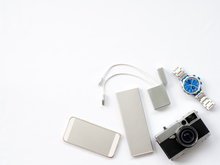 untidy: Flat Lay, Technology Photo, Smart Device Photo with props are smartphone, Watch, power bank, charger, camera and flash drive  situate untidy on white background or isolated with space