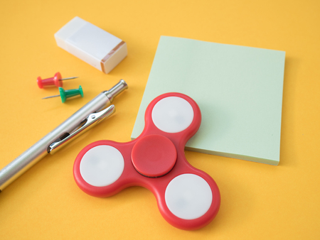 pencil with colorful pins eraser hand spinner and post it stock