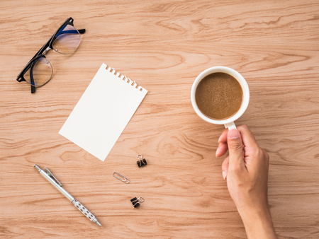 postit note: Flat Lay of coffee cup with conflex and office tools over old wooden background. The concept is wooden workspace with copy space background.