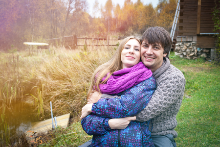Couple of future parents in a country house in the autumn Stock Photo