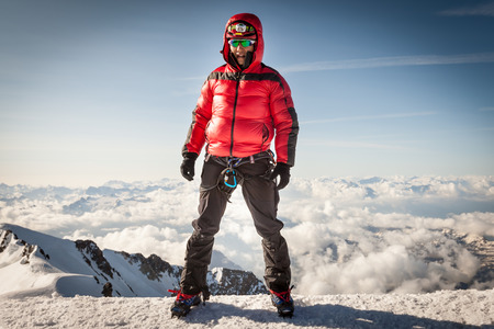 crampons: Climber on the summit of Mont Blanc