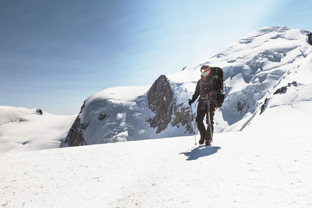 crampons: Climber descends after climbing Mont Blanc Stock Photo