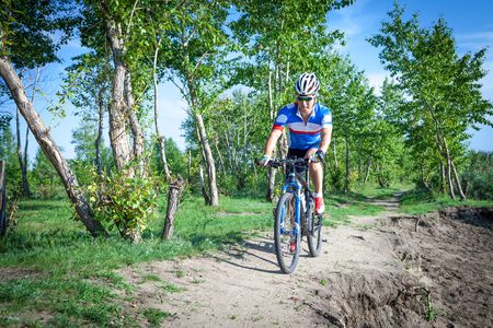 off road biking: Training on a mountain bike cross-country Stock Photo