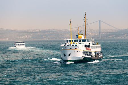 passenger ships: Passenger ships on a background of the Bosphorus Bridge Stock Photo